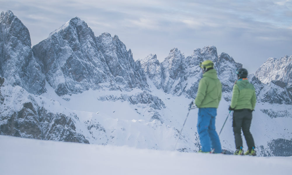 skiing in front of the Dolomites